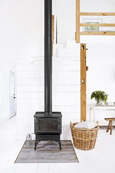 """Though the Regency wood stove adds charm and serves up heat, Angie is always on the hunt for baskets to store blankets. The stove sits atop porcelain """"wood"""" tile. Living Room Hacks, Living Room Styles, Ikea Living Room, Living Room Remodel, Indiana, Home Interior, Interior Design, Style Salon, Damask Decor"""