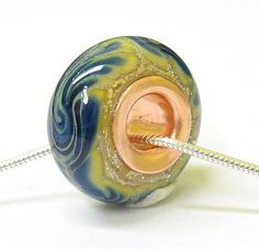 Blaue Blume: Handmade Copper Lined Lampwork Bead / Etsy.