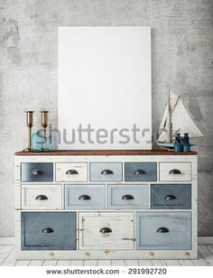 blues/white chest of drawers decorated in beach style