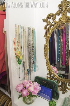 MOUNT hooks on a strip of wood and mount to wall to hang necklace from - dont' forget the mirror to check it out w/ your outfit! And letter organizers do the same thing for your clutch collection. | 21 Useful Things That Will Actually Organize Your Closet