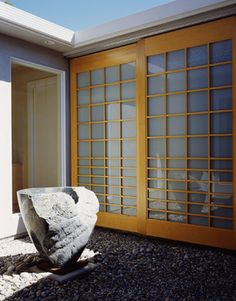 Installing shoji-style doors like these, but with hinges, transforms Your Boutique Closet into a beautiful light sculpture, and improves accessibility.