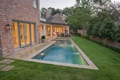 I wouldn't put a pool this close to house, but I like the idea of nice thick grass up to the edge of the pool, rather than cement decking.