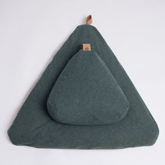 This recycled, 100% organic meditation cushion set with support cushion and bottom floor cushion is the essential set up for meditation and a mindful life. Whether at home, the studio or on the go, you'll get the most out of your practice. Modern, organic and ergonomic, it provides a beautiful, supportive and comfortable place to meditate, sit or relax. When not in use, store it easily on hooks on the wall. Designed and ethically made in California. Free shipping within the USA. Details… Home Yoga Room, Zen Room, Hemp Fabric, Meditation Cushion, Meditation Stones, Cushion Filling, Jade Stone, Floor Cushions, Leather Backpack