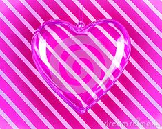 Glass heart pendant over pink and white striped background.