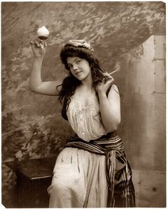 Lady Libertine, 1902.  Another of Fitz Guerin's metaphorical maidens. Back in the sepia days, single women always held shaving cream above their heads while smoking cigarettes.  It was the law...