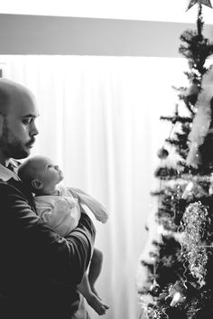Love this! Indoor photography with baby looking at the tree in wonder. :)   I  Petra Veikkola photography