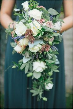 Love the cool colors!  Blue green gown, lavender and roses cascading bouquet.      12 Absolutely Gorgeous Cascading Wedding Bouquets