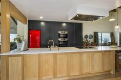 Kitchen, featuring American White Oak island bench. Love the pop of RED.