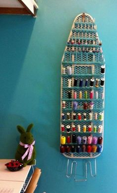 Cute idea for sewing room.Thread Storage with Repurposed Ironing Board. Repurposed Ironing Board For Thread Storage. Never throw away the old ironing board! You can repurpose it for a unique place for your spools of thread in your craft room! Repurposed i Thread Storage, Sewing Room Storage, Sewing Room Organization, My Sewing Room, Craft Room Storage, Storage Ideas, Organization Ideas, Sewing Room Decor, Storage Solutions