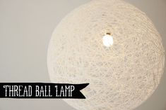 We did this for dance decorations.  Used balloons, yarn and white glue.  Worked better to wrap the yarn or thread, paint with glue, let dry and remove popped balloons.  If glued again on inside would probably hold small strings of twinkle lights.  DIY - Thread ball lamp | By Wilma