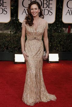 Brides.com: The Most Wedding-Worthy Red Carpet Dresses. Diane Lane at the 2012 Golden Globes. Lane couldn't look more regal—or bridal—in her dress. Nominated for Best Actress, Diane opted for an elegant gold sequin-embroidered cap sleeve gown by Reem Acra.  Browse Reem Acra wedding dresses.