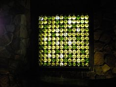 Glass Bottle Wall by arianne_s, via Flickr