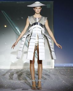 Futurism infiltrated many of the 2009–10 collections, from space-age silhouettes to Star Treky gold leggings to sculpted silver corsets and Lucite heels. As technology continues to evolve, we can expect to see even more forward-leaning silhouettes and robotic accents from the industry's most innovative designers. Hussein Chalayan's mechanical dress from his SS07 collection demonstrates that cutting-edge construction can also be wearable—and beautiful - pinned by RokStarroad.com