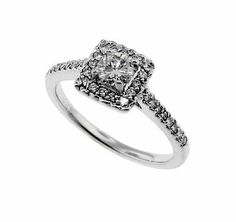 A 14k white gold and diamond engagement ring.  The center diamond is a round brillant cut totaling 0.27 carats with I color and SI2 clarity.  There are 32 round, full cut side diamonds totaling 0.21 carats with G/H color, SI1 clarity.  Priced: $1,300.