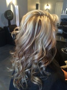 Beautiful white blonde highlights with chocolate brown lowlights.