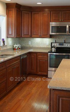 Wolf Classic Cabinets, Hudson Maple Door, Heritage Brown with Black Glaze Finish.  Silestone Countertop Kalahari