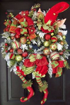 Christmas Elf wreath. Giving me some ideas here. Going to be looking for some elfs at the after Xmas sales, how cute would this be with his arms coming around the sides, like he is holding a too big wreath.  Probably have to do some major elf dissection but would be so cute