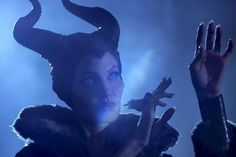 """MALEFICENT (May 30): The untold story of Disney's """"Sleeping Beauty"""" villain. Angelina Jolie takes the title role; Elle Fanning plays Princess Aurora."""