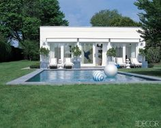Modern Wonder  At the beach retreat of Coach president and creative director Reed Krakoff and his wife, Delphine, in Southampton, New York, the modernist pool and poolhouse reflect the clean-lined 1970s style of the main house.