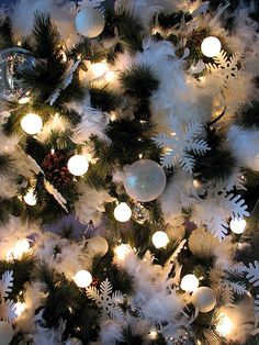 decorate a christmas tree with white feathers!
