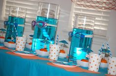 Table decorations:  Large vases filled with blue water w goggles