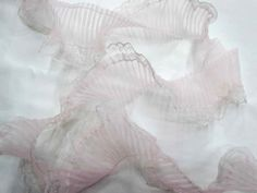 Width of trim: 7cm.  This designer lace trim is soft and sheer. Made from a…