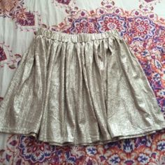 NWOT Gold Metallic Skater Skirt This adorable skirt looks a little bit golder in person. It is 100% polyester which makes it super stretchy. Aeropostale Skirts Circle & Skater