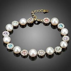 10 Lotus Flower With 9 pearl Colorful Stellux Austrian Crystals Bracelet  #jewelry #womensfashion #earrings #fashion #khaista #rings #women #necklace #dresses