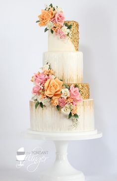 Gold textured wedding cake with orange and pink roses | Sequin Wedding Cakes with metallic gold and silver accents via @BelleMagazine