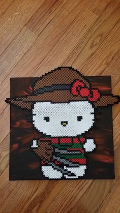Hello Kitty Freddy canvas perler beads by Perleresque Pearler Bead Patterns, Perler Patterns, Perler Bead Art, Perler Beads, Beaded Cross Stitch, Cross Stitch Patterns, Hama Beads Halloween, Nerd Crafts, Weekend Crafts