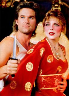 """"""" Jack Burton (Kurt Russell) and Gracie Law (Kim Cattrall) prepare to face-off against some Big Trouble in Little China. Kim Cattrall, Old Movies, Great Movies, Goldie Hawn Kurt Russell, James Hong, China Movie, Non Plus Ultra, Film D'action, Burton"""