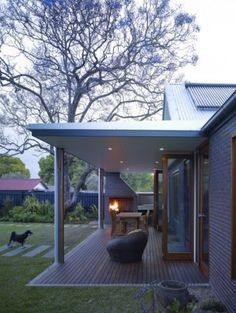 Bi-fold doors leading onto a patio? Check. Cool, modern seating, outdoor fireplace and spacious yard.