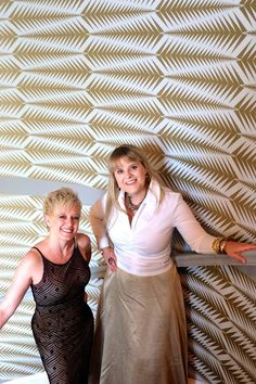 The evening of the Designer House Preview Gala, designers of the entrance hall and stair area, the Bridget Beari team, Rachel Tate Parrish, assistant, and Susan Jamieson, principal, stand on the grand staircase in front of their glorious wallpaper in the 2014 Richmond Symphony Orchestra League Designer House, Hampton Manor, built by Richmond luxury home builder, Bel Arbor Builders, at Hallsley, in Midlothian, VA!