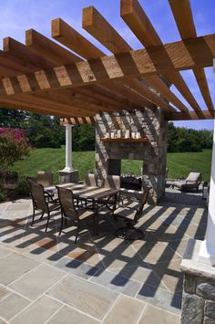 Flagstone dining patio with pergola and fireplace traditional patio