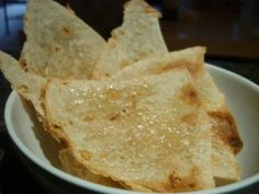 Brown Rice Wraps Cut into chips, brushed with coconut oil and sea salt and then place under the broiler for 3-5 min!