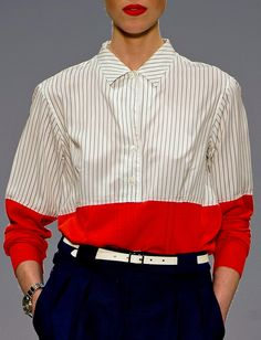 Paul Smith SS13 - Androgynous shirt design. Interestingly composed with vertical pinstripes with a broad horizontal stripe at the bottom of the shirt in block red. High contrast in colour.
