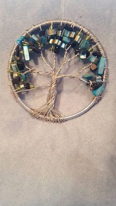 Beautiful Tree of Life. Choose either Autumn or Blue Sky. Perfect as window or wall decor, or hang as an ornament. These art pieces are carefully handcrafted in a 3 ring. Tree Of Life, Arrow Necklace, Art Pieces, Hair Accessories, Wall Decor, Sky, Ornaments, Beautiful, Jewelry