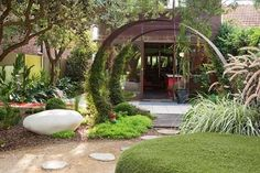 Small #garden design -- The Dr Seuss-inspired #garden blends unique artistic features with modern lines and unusual paintings.
