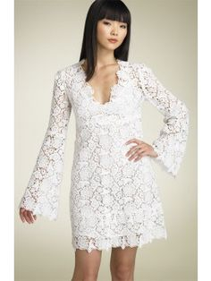 LOVE THIS! LOOKS LIKE THE DRESS MY MOM GOT MARRIED IN! Short Lace Wedding Dress. Would be cute with cowboy boots.