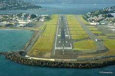 Wellington Airport, New Zealand. surrounded by sea water, yet so near the city. My old home town. Capital Of New Zealand, New Zealand North, Visit New Zealand, The Beautiful Country, Beautiful Places, Tasmania, Wellington New Zealand, New Zealand Houses, South Island
