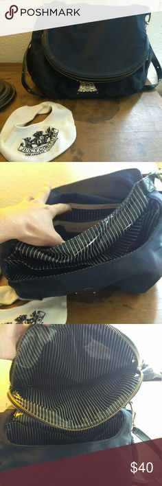 Juicy couture diaper bag Navy blue water proof Juicy diaper bag has multiple pockets w plastic liner inside, comes with juicy bib. In good condition with a bit of wear on strap (shown in pictures) Gladly accepting offers! Juicy Couture Other