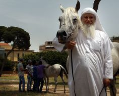 A competitor poses with his horse during a show of Arab horses at the Beirut Hippodrome. (PATRICK BAZ / AFP)