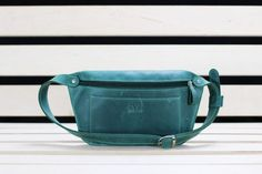 This leather fanny pack is perfect for everyday use. It is made of genuine leather and feels very soft. It has one zipper compartment and one front pocket. Via en.DaWanda.com.