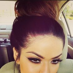 White on waterline and double winged liner..PERFECT. oh, and that fabulous big Bun!!