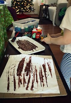 """""""mud"""" painting for the letter Mm:::    MAK Note: Mud painting is really pretty. Try on white fabric like muslin."""
