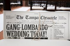A personalized newspaper is a wonderful way to share your love story with your guests.Photo Credit: Carrie Wildes Photography