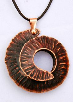 "Pendants - Foldformed copper. Natural patina, the result of the annealing process. Approx. 3"" x 3""."