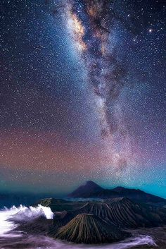 Steve Lance Lee's photos show the Milky Way galaxy arching over volcanoes in Indonesia, offering a breathtaking view of countless twinkling stars and beautiful, vibrant color across the night sky.