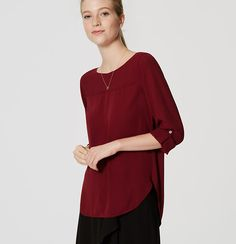 Subtle seamed detail lends utilitarian allure to this fluid essential. Round neck. Long sleeves with button cuffs and roll button tabs. Seamed yoke and center front. Back pleats. Shirttail hem.