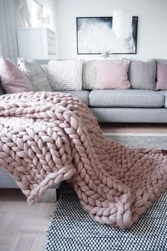 Chunky Bed Runner - $123 - This narrow version is ideal for adding a touch of texture to the end of your bed. See more chunky knit blankets to cuddle with this winter at HouseBeautiful.com.